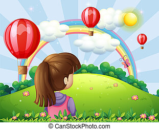 A young lady watching the floating balloons and rainbow -...