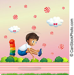A boy exercising in the candyland