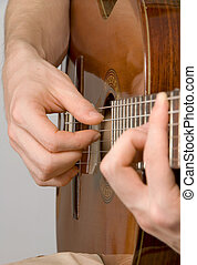 Pickung the classical guitar - Hands of male guitarist...