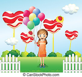 A girl in the candyland with eight balloons
