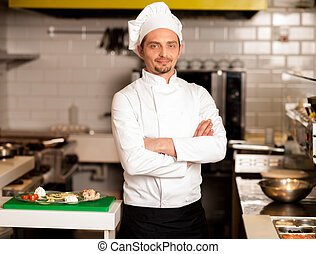 Confident young chef posing - Confident young male chef...