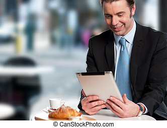 Handsome manager reviewing business updates - Corporate male...