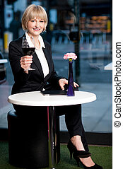 Gorgeous corporate woman enjoying red wine - Beautiful...