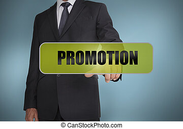 Businessman touching the word promotion written on green tag...