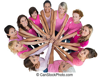 Cheerful women joined in a circle and looking up at camera...