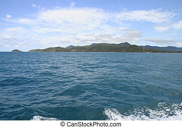 Koh Phangan island in Thailand - View from ferry boat upon...