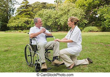 Smiling man in a wheelchair talking