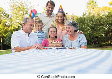 Happy extended family celebrating little girls birthday...