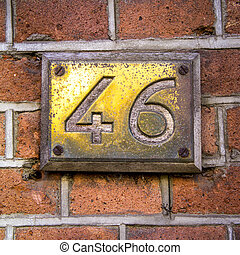 Number 46 - House number forty-six, engraved in a brass...