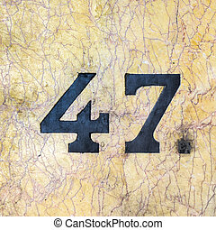 Number 47 - house number forty-seven, inlaid in a marble...