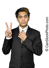 Young Indian businessman making V-sign - Young dynamic...