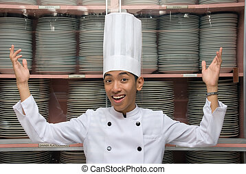 Chinese chef showing dishes - Young male smiling Chinese...