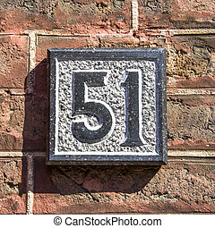 Number 51 - house number fifty-one, carved in natural stone