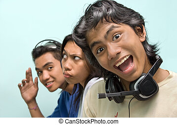 Merry Asian callcenter - Portrait of three young Asian...