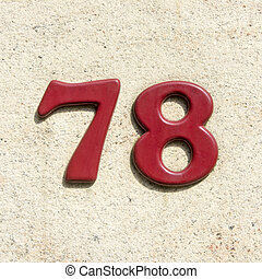 number 78 - cast plastic house number seventy-eight. Red...