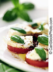 Fresh caprese salad with delicious tomatos mozzarella and...