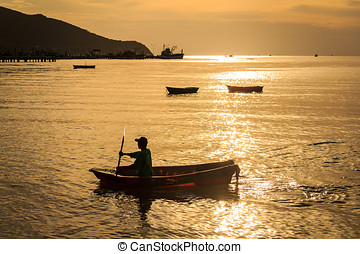 Fisherman On The Sea With Sunset