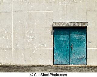 Old Green Steel Double Door and concrete Wall
