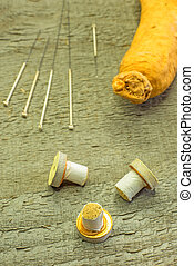 acupuncture needles, moxibustion cones and ginseng root