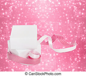 White boxes with gifts with pink ribbons on the beautiful...