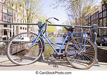 Old bike on a bridge in Amsterdam the Netherlands
