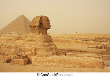 The Sphinx and Great Pyramid of Khufu in a sand storm,...
