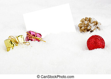 Blank white card with christmas decoration in the snow