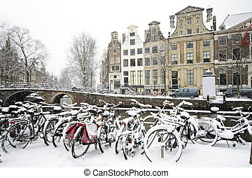 Bicycles in the snow in Amsterdam the Netherlands