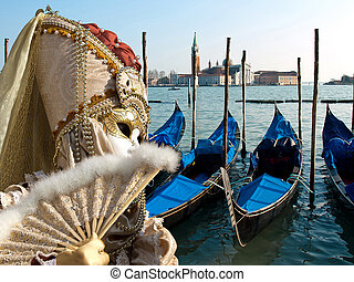 gondola - mask and gondola boats waiting for turists in the...