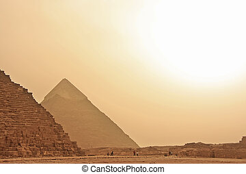 Great Pyramids of Giza in a sand strom, Cairo, Egypt