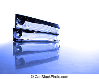 Business Binders on Desk - Office desk with business binders...