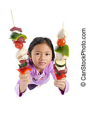 kabobs - A young asian girl with fresh kabobs ready to grill