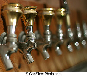 Taps - Row of dusty old beer taps in an abandoned bar