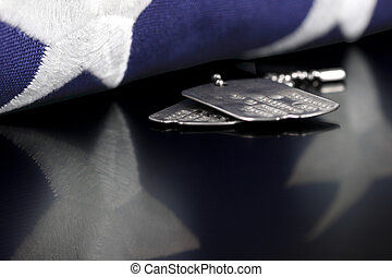 Dog Tags - Dog tags or ID tags, once worn by a military...