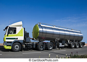 Oil car - A truck with a big tank for delivering liquid...
