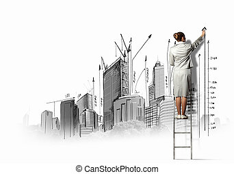 Businesswoman drawing on wall - Businesswoman standing on...