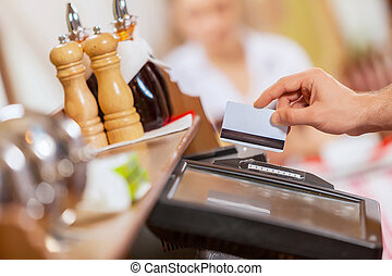 Close-up of cashier hands - Close-up image of cashier male...