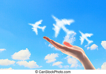 Close up of hand with airplanes symbols - Close up image of...