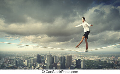 Businesswoman balancing on rope - Image of businesswoman...