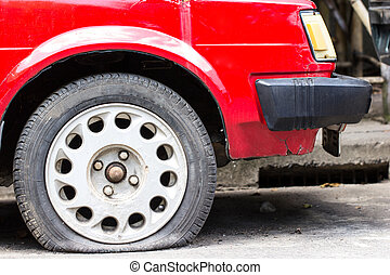 Close up Flat tire on the road waiting for repair