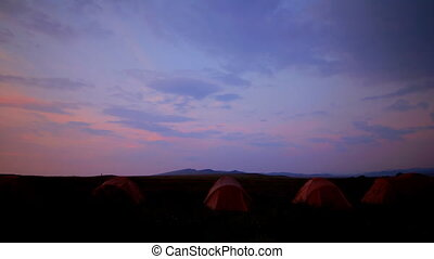 tourist tent on nature sunset time lapse