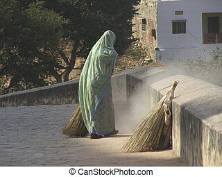 woman sweeping - indian woman on a street sweeping in Agra