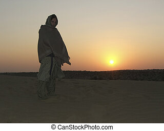 young woman in rajistan desert - young woman dressed in...