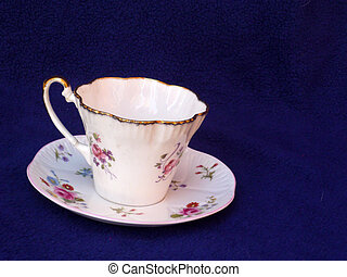 China cup and saucer - china cup and saucer with red rose...