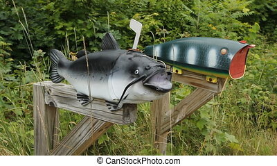 Fishing mailboxes. - Fish and fishing lure mailboxes in...