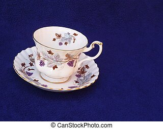 China cup and saucer with purple rose pattern