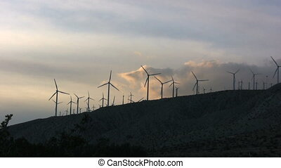 Wind Farm at Sunset - a wind farm stands against the sunset