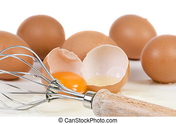 Wisk and Eggs - A broken egg and wisk ready to be mixed...
