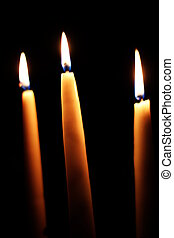 Three Candles On A Black Background - Three candles burning...