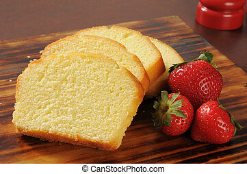 Pound cake and strawberries - Slices of rich moist pound...